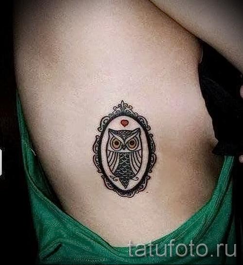 tatouage hibou sur les côtes - une photo avec un tatouage sur l'exemple 03022016 3