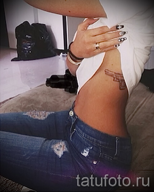 tattoo gun on the ribs - Photo example of a tattoo on 03022016 2