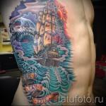 vieux tatouage de l'école sur les côtes - par exemple Photo d'un tatouage sur 03022016 1