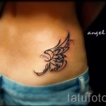 wing tattoo on her hip 1