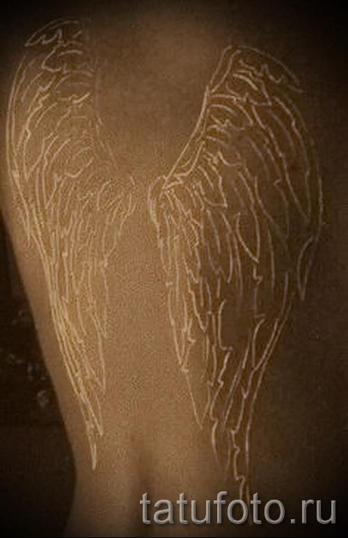 tatouage ailes blanches - photo avec un mode de réalisation du motif fini de 29032016 1