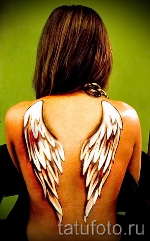 tattoo white wings - photo with an embodiment of the finished pattern of 29032016 1