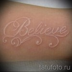 white lettering tattoo 2