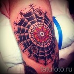 spiderweb tattoo on his knee 1