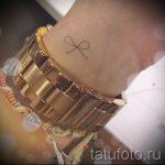 тату бантик маленький - фото пример готовой татуировки 02052016 7