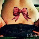 тату бантик на пояснице - фото пример готовой татуировки 02052016 1