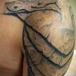 тату на плече мужские кожаные доспехи фото - пример готовой татуировки от 16052016 4