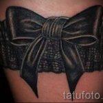 тату подвязка с бантиком на ноге - фото пример готовой татуировки 02052016 10