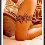 тату подвязка с бантиком на ноге - фото пример готовой татуировки 02052016 14