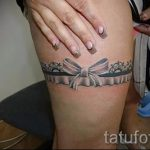 тату подвязка с бантиком на ноге - фото пример готовой татуировки 02052016 15