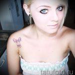 Bogen Tattoo auf ihrem Schlüsselbein - Foto Beispiel des fertigen Tätowierung 02052016 3