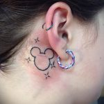 Mickey Mouse tattoo behind the ear 1