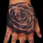 Rose tattoo on his hand Man 1