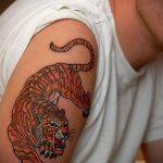 Tiger tattoo on his arm Man 1