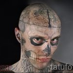 a guy with a skull tattoo on his face - a photo example 1