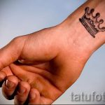 photo crown tattoo on his wrist for the guys 1