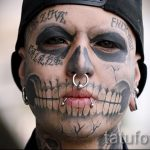 Eduardo Henriquez, 19, of Chile poses for pictures, featuring his eyeball tattoo and facial tattoos during the latin america convention of tattoo and suspension in Valparaiso city
