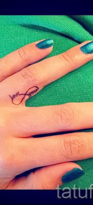 value infinity tattoo on his finger — an example of the finished tattoo in the photo 1