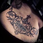 тату кружева на пояснице - фото пример готовой татуировки 2
