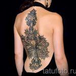 тату кружева на спине - фото пример готовой татуировки 1
