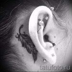 тату перо за ухом - фотографии вариантов готовых татуировок 1