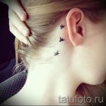 bird tattoo behind the ear 1