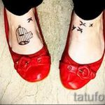 bird tattoo on her ankle - great photo of the finished tattoo 1