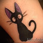 cat tattoo on her ankle - great photo of the finished tattoo 2