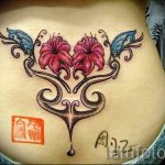 coccyx tattoo lettering 2