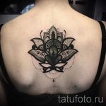 dentelle tatouage sur son dos - par exemple Photo du tatouage fini 1