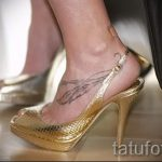 feather tattoo on her ankle - great photo of the finished tattoo 1