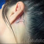hummingbird tattoo behind the ear 2