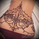 lace tattoo on the lower back 2