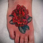 peonies tattoo on her ankle - great photo of the finished tattoo 1