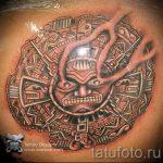 оригинальная татуировка с солнцем - фото