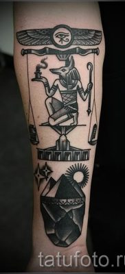 Anubis tattoo on his forearm – tattoos photo for an article about the importance of 1