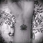 Lilie Tattoo auf dem Arm - eine Tätowierung des Foto Beispiel 13072016 1