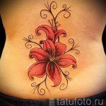 Lilie Tattoo auf dem Rücken - Foto Beispiel der Tätowierung 13072016 1