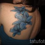 lily tattoo on her back - Photo example of the tattoo 13072016 3