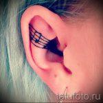 тату ноты в ухе - фото готовой татуировки от 02082016 3084 tatufoto.ru