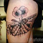 тату ноты в цветах - фото готовой татуировки от 02082016 4088 tatufoto.ru