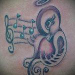 тату ноты и птицы - фото готовой татуировки от 02082016 4102 tatufoto.ru