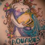 Aquarius tattoo on his arm - photo - an example of the finished tattoo 01082016 1026 tatufoto.ru