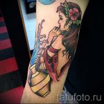 Aquarius tattoo on his forearm - photo - an example of the finished tattoo 01082016 2029 tatufoto.ru