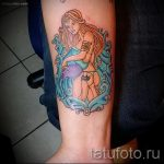 Aquarius tattoo on his forearm - photo - an example of the finished tattoo 01082016 3030 tatufoto.ru