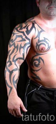 Foto – Tribal Tattoo auf seinem Arm – ein Beispiel für einen Artikel über die Bedeutung der 1009 tatufoto.ru