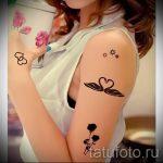 tatu-dva-lebedya-foto-primer-gotovoj-tatuirovki-7044-tatufoto-ru