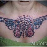 тату пистолеты на груди - фото готовой татуировки 01092016 16185 tatufoto.ru