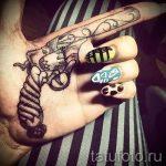 тату пистолет у девушек - фото готовой татуировки 01092016 6158 tatufoto.ru