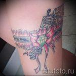 тату подвязка с пистолетом - фото готовой татуировки 01092016 2203 tatufoto.ru